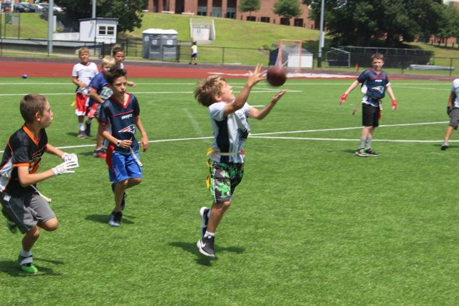 Catch at Youth Flag Football Camp